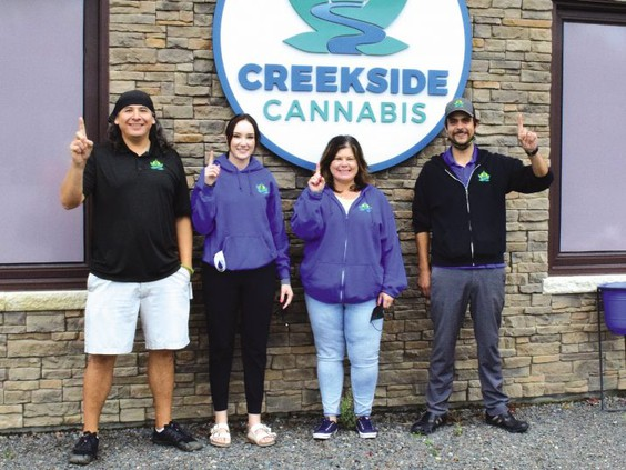 employees outside a cannabis store