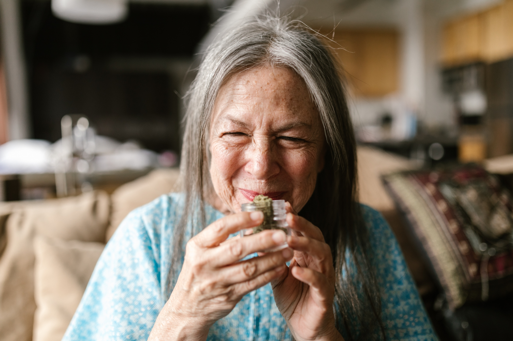 older woman holding Cannabis