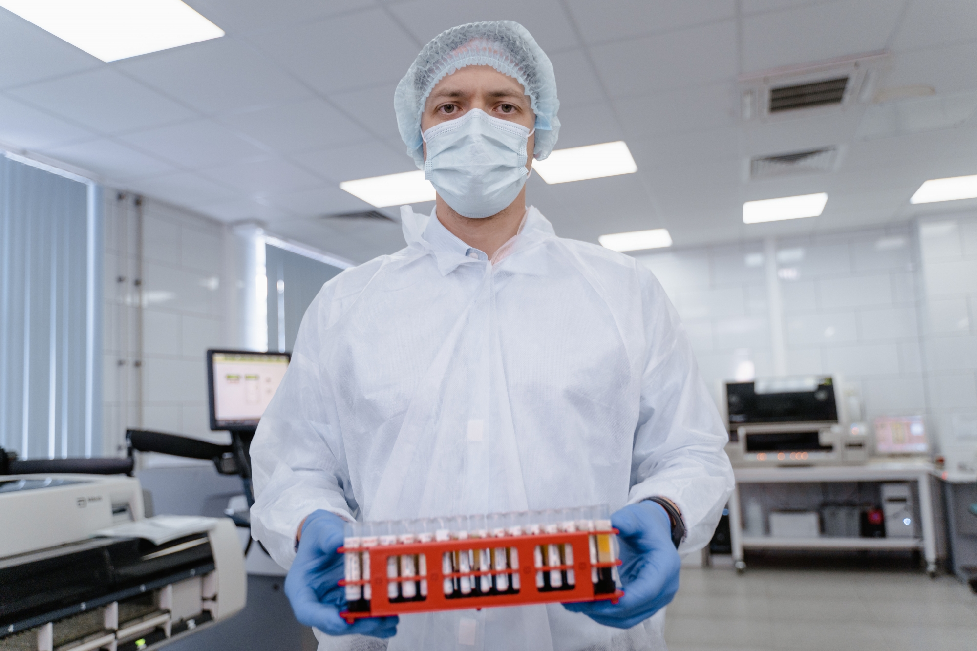 lab technician holding test tubes