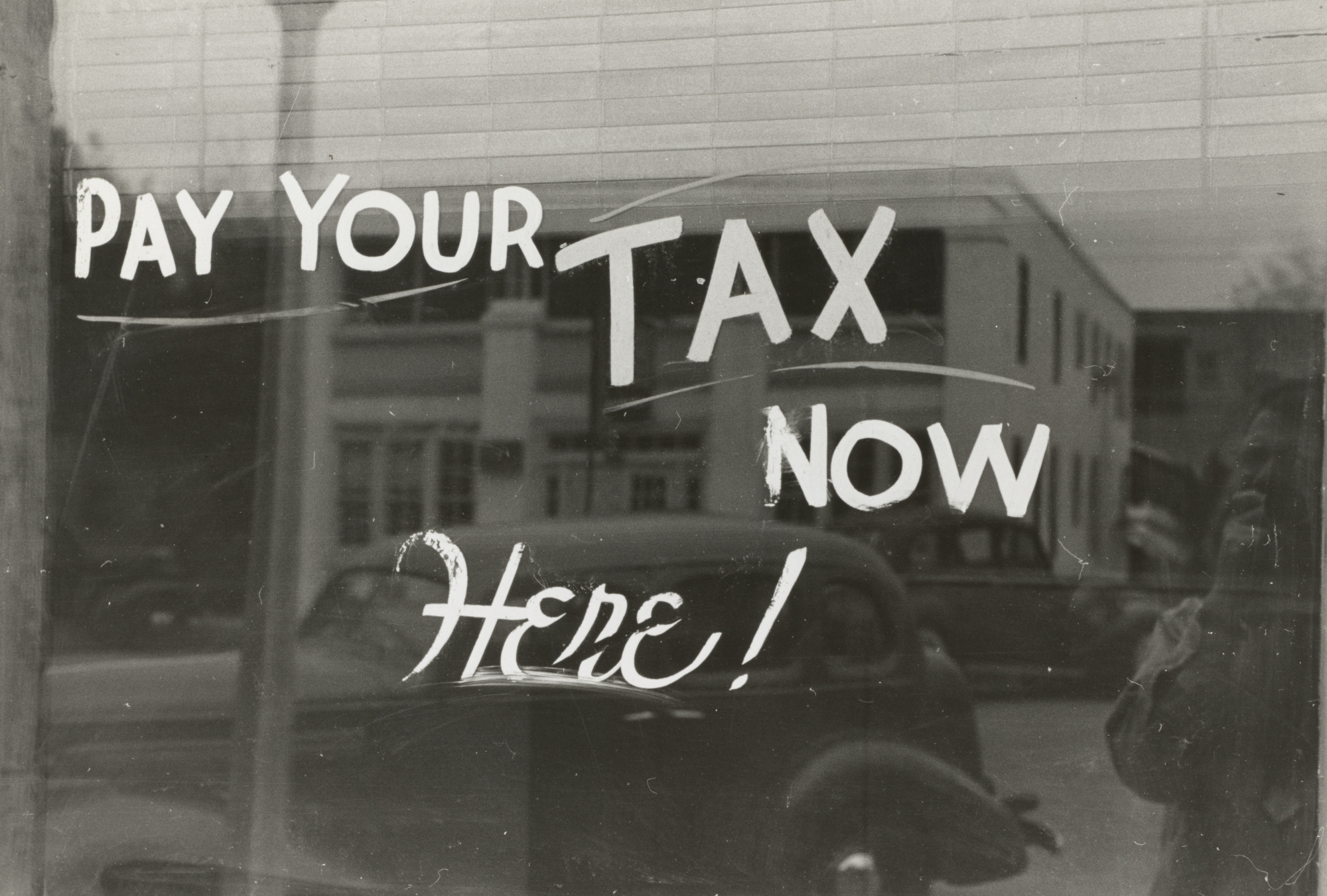 Pay your taxes here written on store window