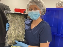 woman holding a bag of cannabis